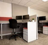 Raised cubicle with drafting chair
