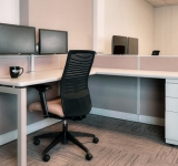 low_walled cubicle with global loover chair