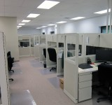 ROSI'S glass-paneled Cust. Svc. cubicles