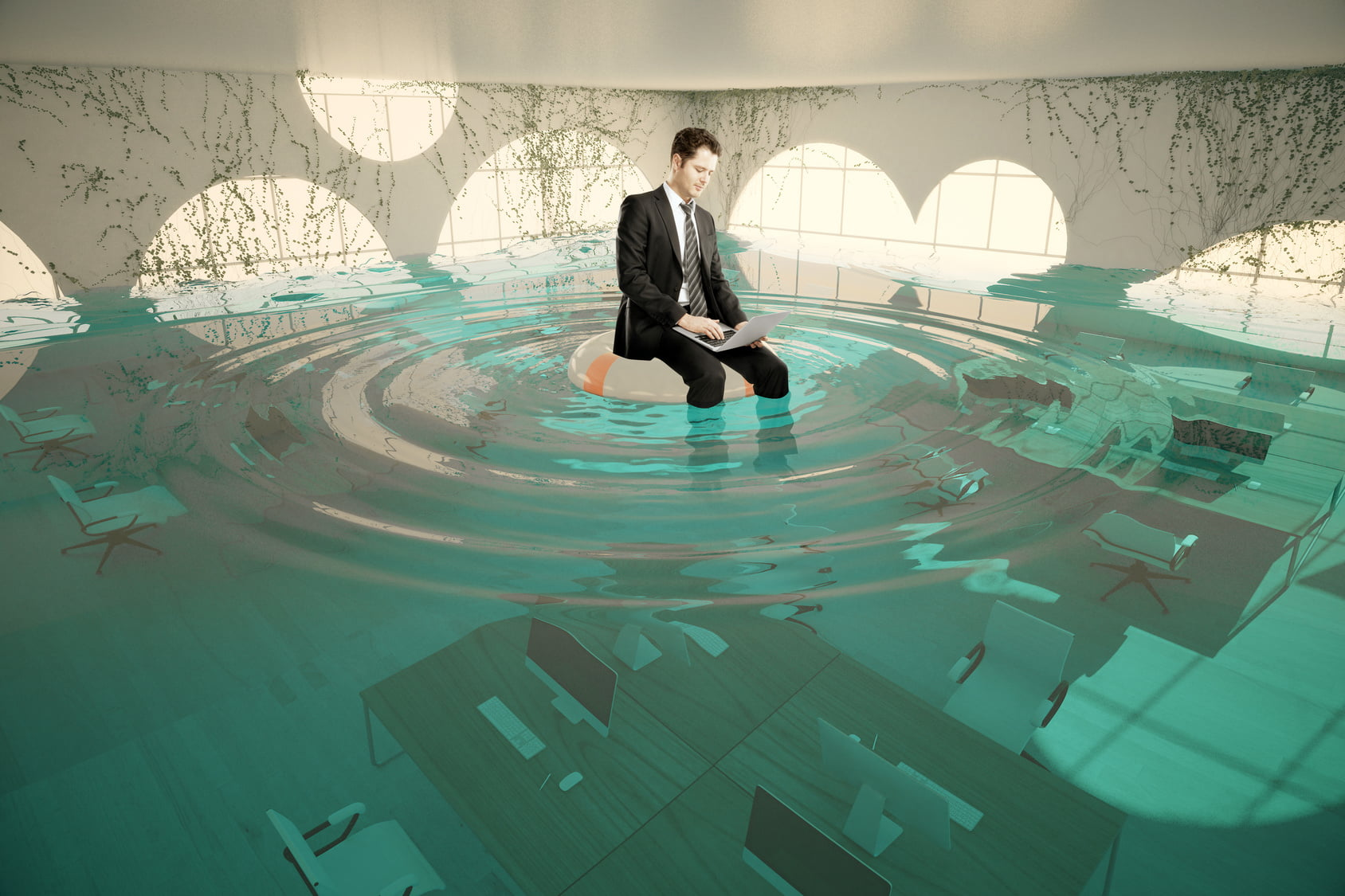 office worker on top of desk surrounded by water