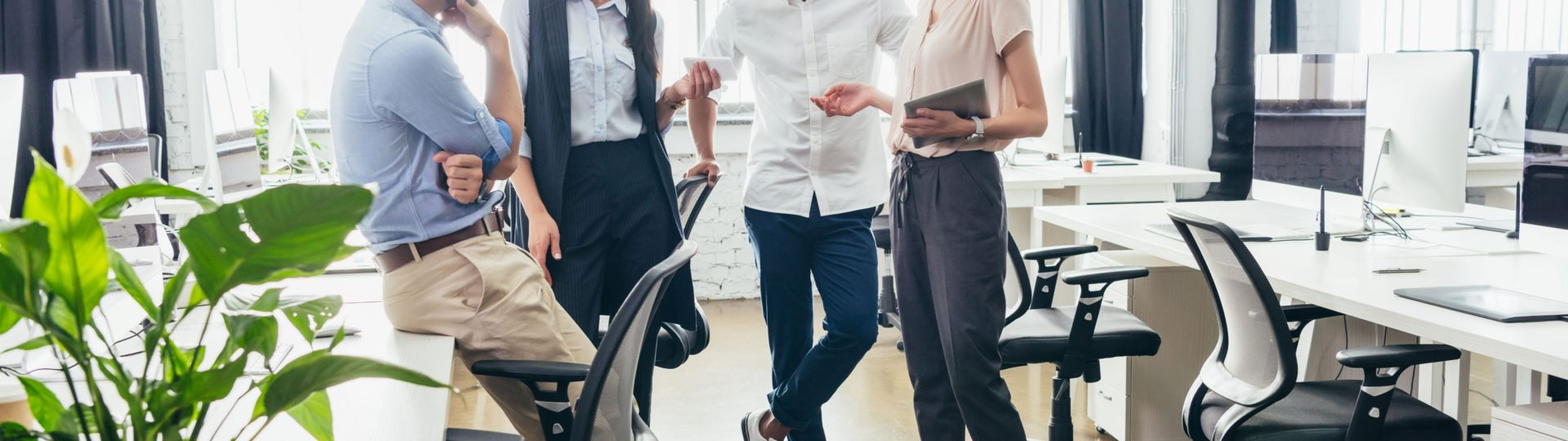 young attractive business associates in casual work attire