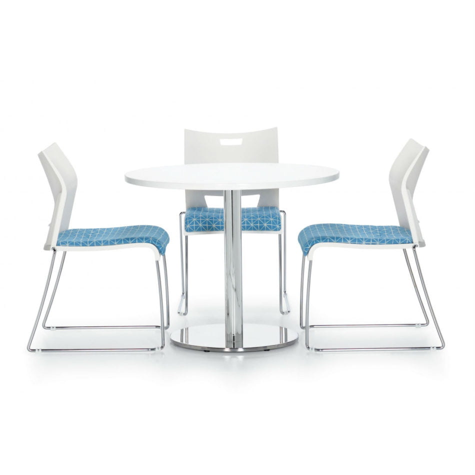 white cafe table with modern blue and white metal chairs