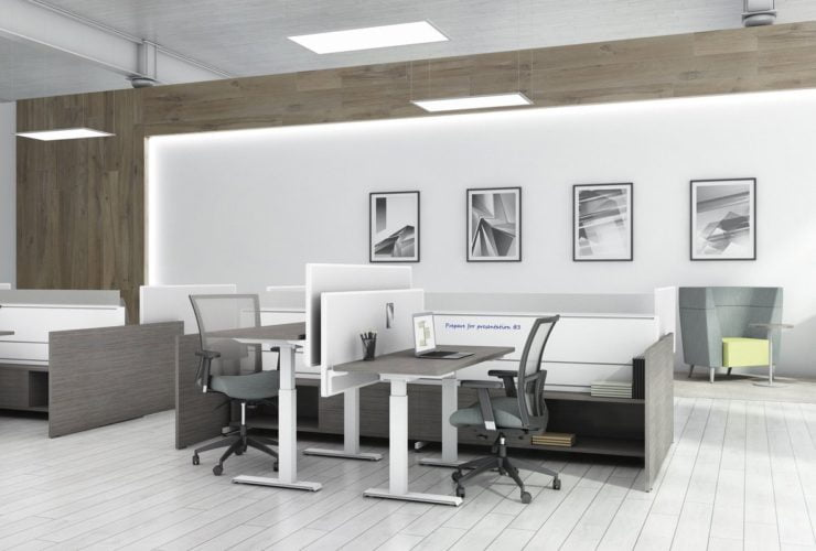 Two sets of Global's 4-person power beam desks.Each workstation has a laptop open. To the user's right are credenzas with Acoujou paneling