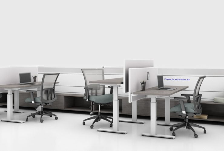 Global's 8-person power beam desks in a white studio setting. Each workstation has a laptop open. To the user's right are credenzas with Acoujou paneling