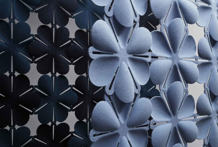 Studio shot of Airbloom acoustic panels forming two partitions. The set in front is in a light periwinkle, with a dark blue color contrast in the partition behind.