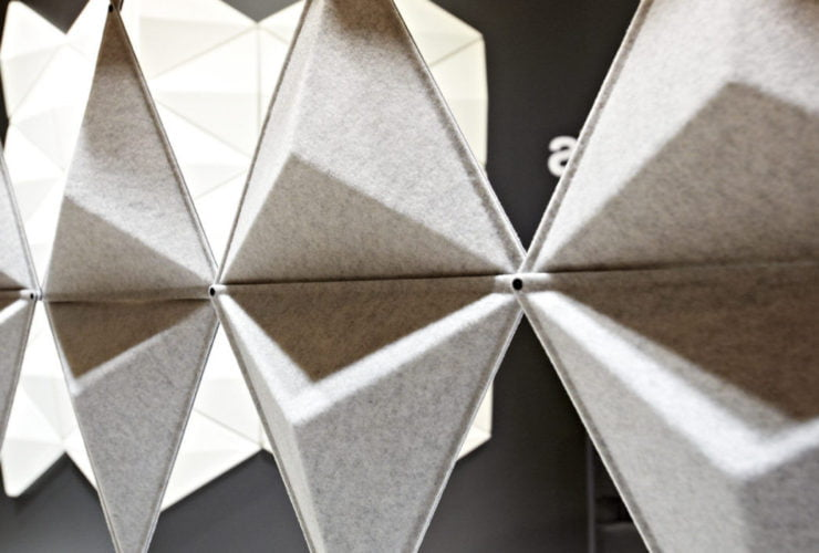 Close-up of Aircone acoustic wall panels inside an exhibition space.