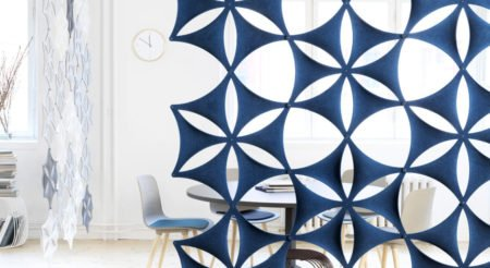 Studio shot of Airflake acoustics set as an artistic partition for a table and chairs.
