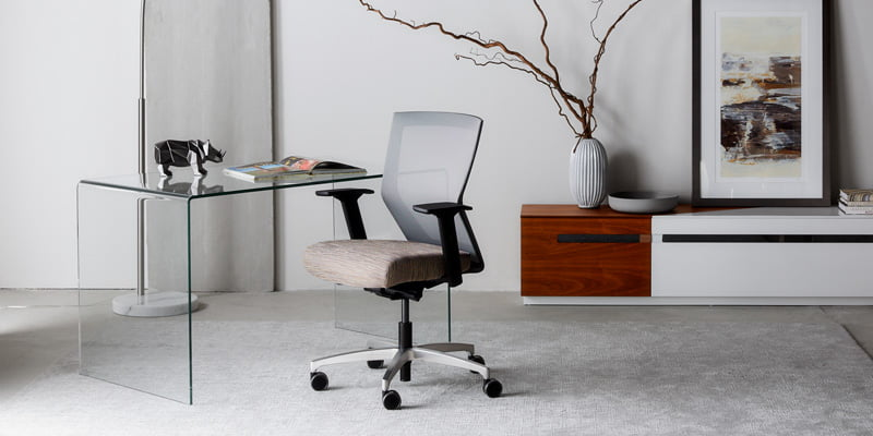 Grey Mesh Mid Back RunII Chair At Glass Table In Decorated Office Area